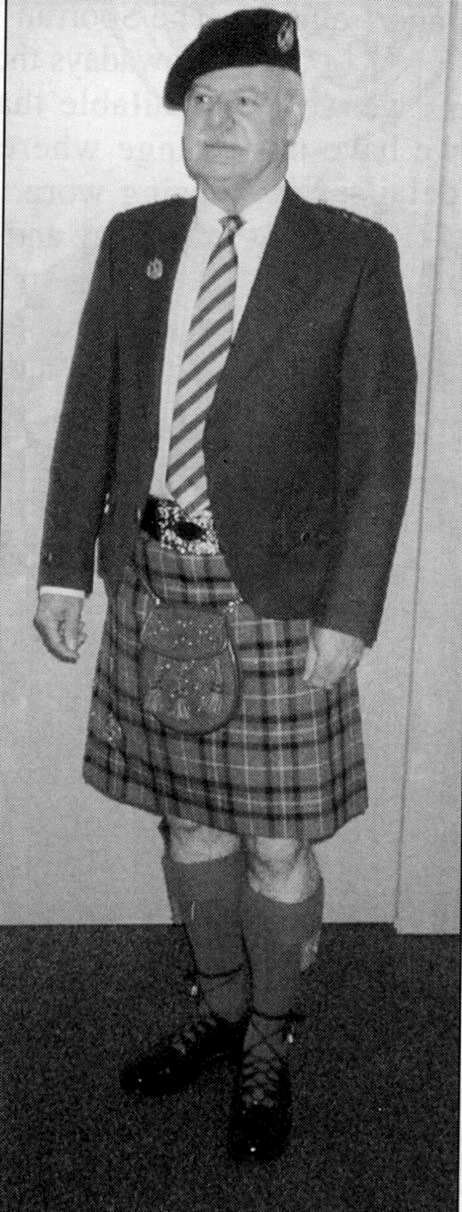 The author demonstrates how Highland dress should be worn